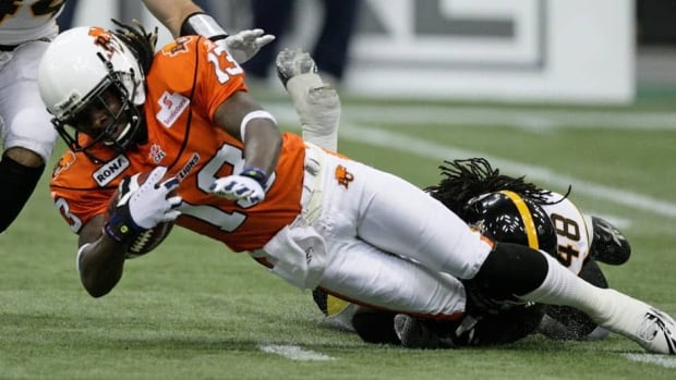 Yannick Carter, right, joins the Calgary Stampeders after an injury-plagued campaign with the Hamilton Tiger-Cats in 2012.