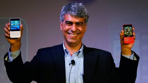 BlackBerry India Managing Director Sunil Lalwani holds BlackBerry Q5 smartphones during its launch in July. A New York-based financial analyst says the company should sell its hardware manufacturing business if Christmas sales are disappointing.