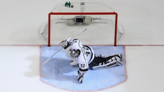 Jonathan Quick of the Los Angeles Kings stretches prior to the beginning of overtime against the St. Louis Blues in Game 1 on Tuesday.