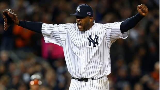 New York starter CC Sabathia reacts after getting out of an eighth-inning jam.