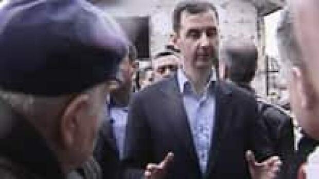 220-syria-assad-02400408