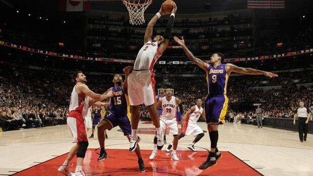James Johnson (2) of the Toronto Raptors goes to the basket against Matt Barnes (9) of the Los Angeles Lakers on Sunday.