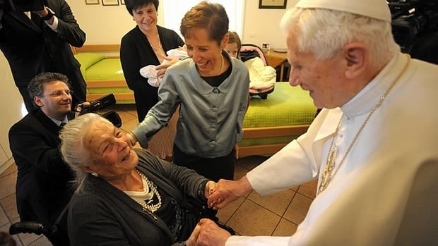 Pope Benedict (right) visits an elderly home of the Sant'Egidio community in Rome on Monday.