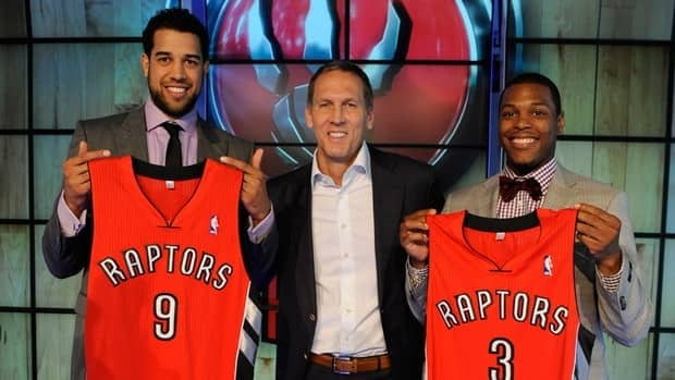 Off-season acquisitions Landry Fields, left, and Kyle Lowry, right, are part of the reason why Toronto Raptors general manager Bryan Colangelo, centre, feels optimistic about the upcoming season.