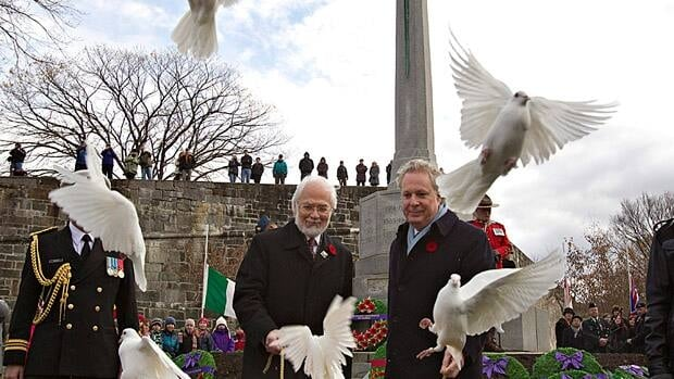 Quebec Premier Jean Charest, right, and Lt. Gov. Pierre Duchesne free doves at the cenotaph during a Remembrance Day ceremony last November in Quebec City.