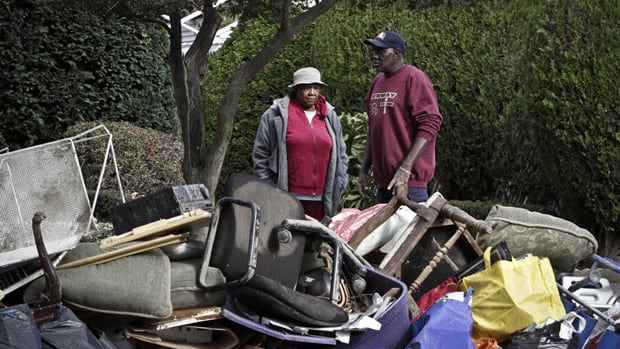 Ruby McLean, 89, and her son Kenneth Davis survey destroyed items from their home, as they clean up from flooding in the aftermath of superstorm Sandy in Brooklyn, N.Y.