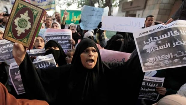 Protesters outside the U.S. Embassy in Cairo demonstrate their outrage over a movie produced in the U.S. they say insults the Prophet Muhammad. The protests also spread to Libya, where an American consulate employee was shot dead, according to a Libyan security official.