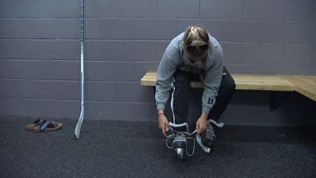 Megan O'Neill laces up her skates after the Dalhousie women's varsity team was forced to forfeit its season.