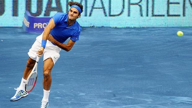 Roger Federer follows through on his serve Saturday in Madrid.