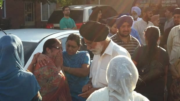 Family and friends mourn the death of 80-year-old Joginder Singh, who was struck and killed by a vehicle early Monday morning on Timberlane Drive in Bramtpon.