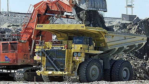 A excavator loads over burden rock into a heavy hauler at the Diavik diamond mine at Lac de Gras, approximately 300 km northeast of Yellowknife, in 2003.