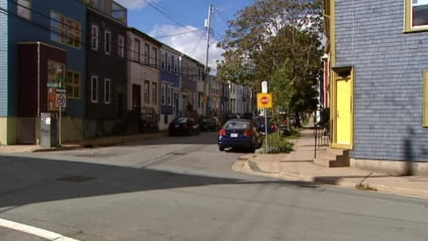 Police say a woman was walking near the corner of Falkland and Maynards streets when a man grabbed her.