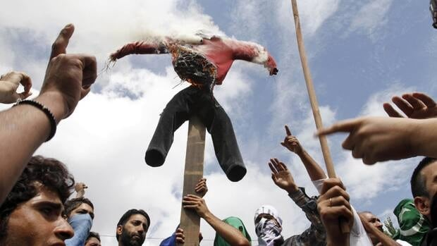 Kashmiri Muslim protesters burn an effigy representing the United States as they shout slogans during a protest in Srinagar on Tuesday. The protest was held against an anti-Islam film called Innocence of Muslims that ridicules Islam's Prophet Muhammad.