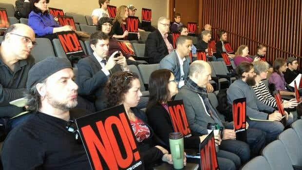 Residents rally against the Hamilton casino proposal at a city hall meeting Dec. 13. Samantha Craggs/CBC