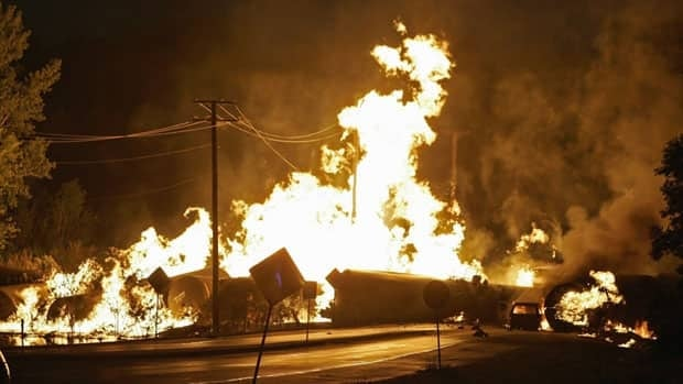 Rail cars loaded with thousands of gallons of highly flammable ethanol are seen engulfed in flames from a Canadian National Railway freight train that derailed in Cherry Valley, Ill. on June 19, 2009.