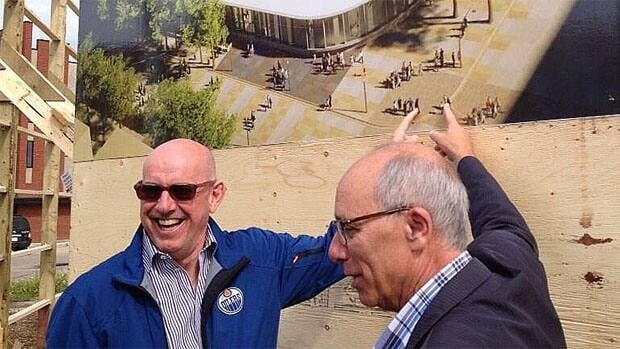 Edmonton Oilers president Patrick Laforge and Mayor Stephen Mandel unveil a new sign at the site of the proposed downtown arena at 104th Street and 104th Avenue.
