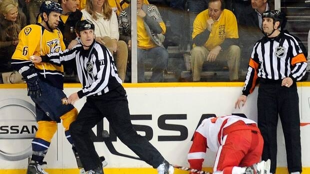 Nashville Predators defenceman Shea Weber (6) received a $2,500 US fine for ramming the head of Red Wings forward Henrik Zetterberg, second from right, into the glass.