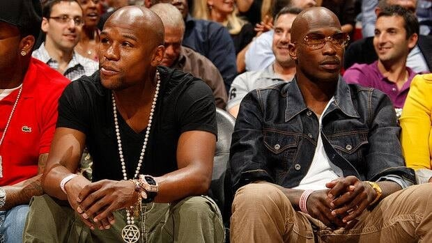 "NFL WR Chad Johnson, right, seen here with WBC boxing champion Floyd Mayweather Jr., raised eyebrows when he changed his last name to ""Ochocinco"" four seasons ago."