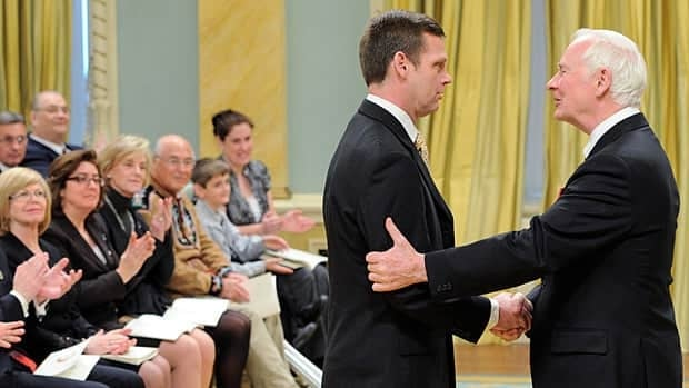 Governor General David Johnston presents the Queen Elizabeth II Diamond Jubilee Medal to Darrell Fox, brother of Terry Fox, during the inaugural presentation ceremony at Rideau Hall in Ottawa on Monday.
