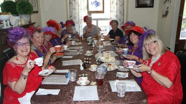 Members of the Red Hat Society discussed the royal baby at the Vintage Garden Tearoom.