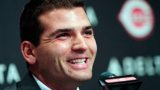 Joey Votto smiles during a news conference announcing his 12-year contract with the Cincinnati Reds on Wednesday. Baseball fans took to Twitter and Facebook to weigh in on the mammoth deal.