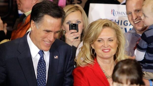 U.S. Republican presidential hopeful Mitt Romney and his wife, Ann, arrive at his election night party Tuesday night in Novi, Mich., after winning the state's primary.