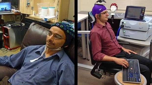 Rajesh Rao, left, plays a computer game in his mind and was able to trigger the finger of colleague Andrea Stocco, right, who wears a magnetic stimulation coil over the left motor cortex region of his brain.