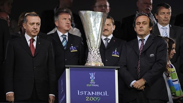 Turkish Prime Minister Recep Tayyip Erdogan (L) and UEFA President Michel Platini (R) are pictured with the UEFA Cup trophy