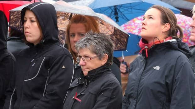 The family of Bromont, Que., police Const. Vincent Roy who died in the line of duty on December 1, 2011, take part in the Canadian Police and Peace Officers annual memorial service on Parliament Hill, in Ottawa, on Sept. 30, 2012.