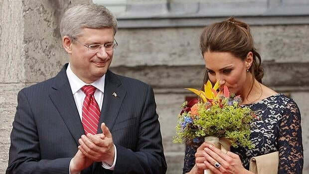 Prime Minister Stephen Harper applauds during an official welcome ceremony for the Duke and Duchess of Cambridge at Rideau Hall in June 2011. On Monday, Harper and his wife Laureen issued a statement congratulating the royal couple on their 'wonderful news.'