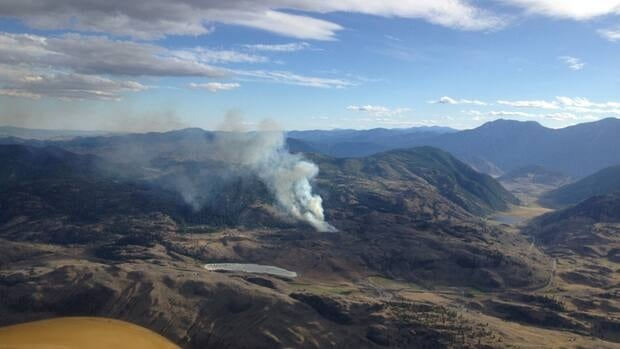 B.C. firefighting crews took to the air to try and contain a wildfire 10 km west of Osoyoos Monday evening.