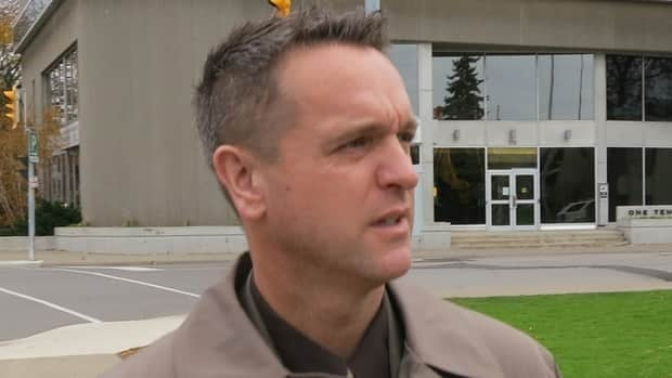 Niagara Regional Police officer Const. Geoff Purdie leaves a disciplinary hearing Tuesday in St. Catharines, Ont.