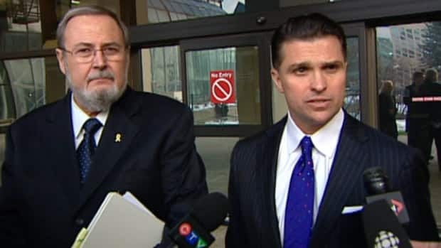 Peter Goldring (left) and his lawyer Dino Bottos spoke to reporters outside the Edmonton law courts on Friday afternoon.