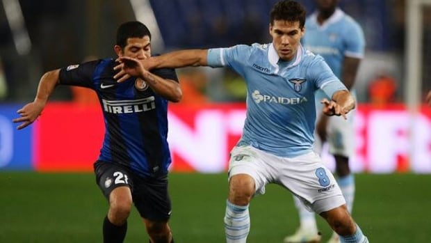 Walter Gargano of Inter Milan, left, competes for the ball with Anderson Hernanes of Lazio.