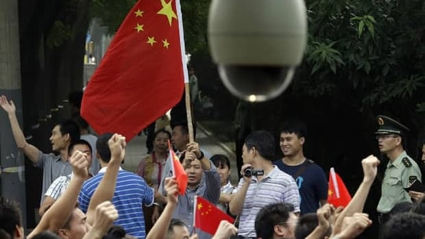 Chinese protesters gather outside the Japanese Embassy in Beijing on Tuesday. Chinese government ships are patrolling near contested East China Sea islands in a show of anger after Tokyo moved to assert its control in the area.