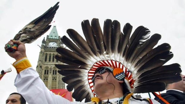 Chief Morris Shannacappo of Rolling River First Nation holds an eagle feather below the Peace Tower on Parliament Hill during a demonstration in 2002. Idris Elbakri has struggled to reconcile his desire to celebrate the good in his adopted country on Canada Day with the wrongs perpetrated against Indigenous people.