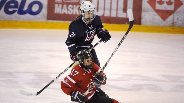 Bailey Bram of Canada, front, and Hilary Knight of USA during the gold medal match in Vantaa, Finland, on November 10, 2012.