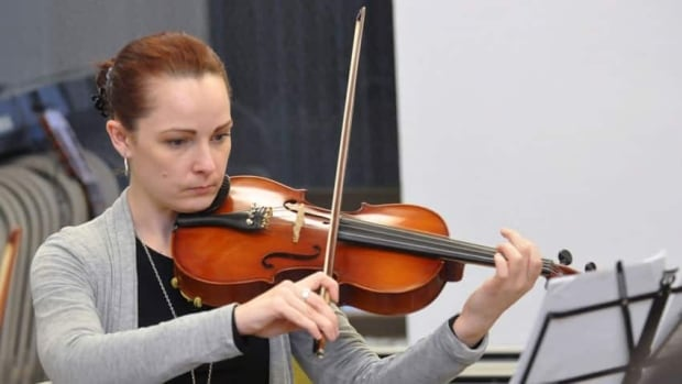 Sarah Jane Coffman served a 14-year sentence for second-degree murder, then returned this year as a free citizen to perform with the prison orchestra.