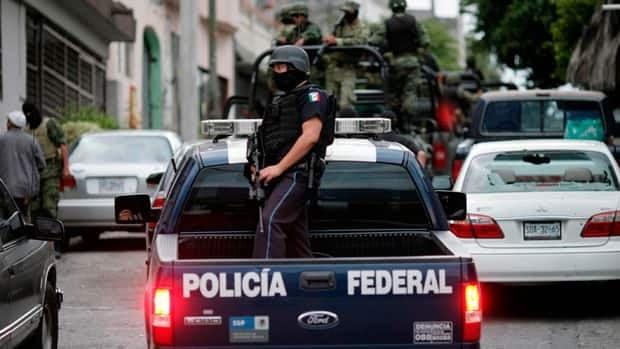 hi-bc-120305-gangs-mexico-8col