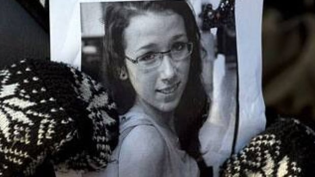 A woman holds a photo at a community vigil to remember Rehtaeh Parsons at Victoria Park in Halifax on April 11, 2013. A man, who was 17 at the time he was charged with child pornography linked to the Parsons case, was given probation during a sentencing hearing Thursday.