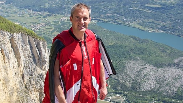 Mark Sutton, who posed as James Bond for Daniel Craig while parachuting down to the London Olympics opening ceremony, died when he crashed into a mountain ridge in the Swiss Alps after jumping off a helicopter.