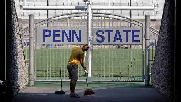 A worker sweeps the tunnel leading to the field at Beaver Stadium before the Penn State football team's annual college football media day on Aug. 9.