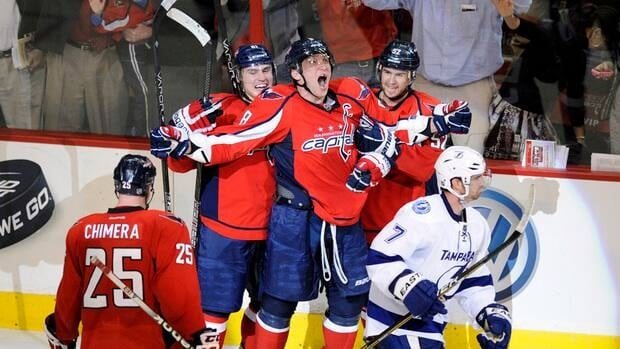 Washington Capitals captain Alex Ovechkin, centre, celebrates his game-winning goal with teammates Mike Green, right, Dmitry Orlov, second from left, and Jason Chimera as Tampa Bay defenseman Brett Clark skates away after the overtime winner.