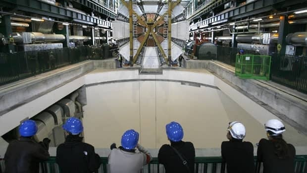 The last element of the ATLAS experiment is lowered into the cave at the European Organization for Nuclear Research, or CERN, in Meyrin, near Geneva on Feb. 29, 2008.