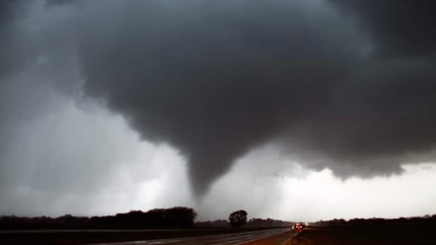 Environment Canada says the first tornado of 2016 was confirmed 7 km outside of Clifford, Ont., on Wednesday, though this image is of a past tornado.