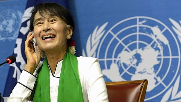Burmese opposition leader Aung San Suu Kyi laughs during a news conference at the annual meeting of the International Labour Organization in Geneva on Thursday.