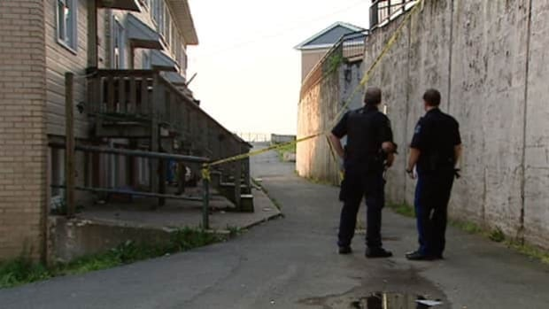 Police investigate the Ryan White shooting in Halifax's Mulgrave Park housing complex in 2010. (CBC)