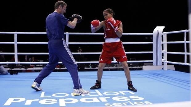 British lightweight champion Natasha Jonas, right, wears traditional boxing shorts as she trains at the Olympic boxing venue.