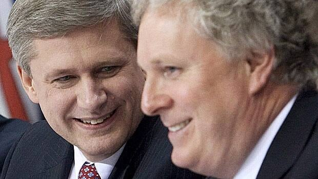 Prime Minister Stephen Harper speaks with Quebec Premier Jean Charest, right, in Ottawa, on Jan. 16, 2009. Struggling to keep his political life afloat, Jean Charest shouldn't expect a lifeline from Stephen Harper, says an ex-strategist for the prime minister.