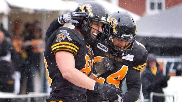 Hamilton Tiger-Cats receiver Andy Fantuz, left, is congratulated by teammate Daryl Stephenson after he caught a touchdown pass on Saturday.